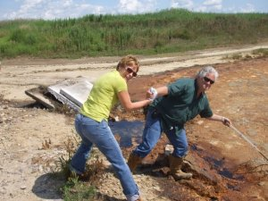 Trying to get a sludge sample from cattle waste lagoon.  It's no wonder I don't eat meat any longer!